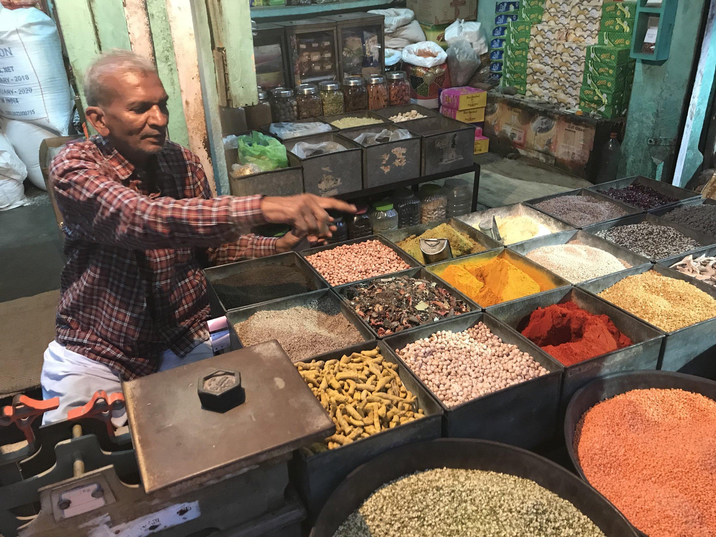 Raj man with spices.jpg