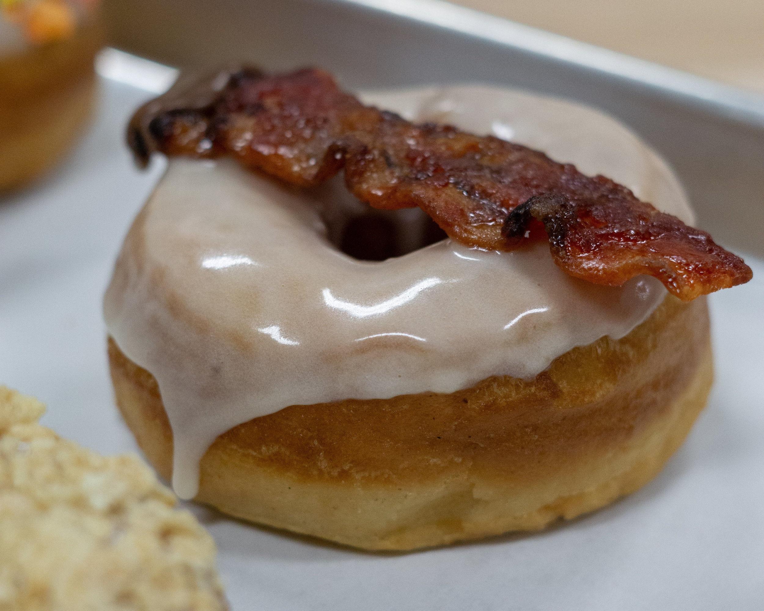 "D Magazine: Head to Dough Boy Donuts for the Maple Donut - ""Their doughnuts are excellent. The doughnut itself is thicker and larger than most. They've got heft, yet still remain airy and soft…"""
