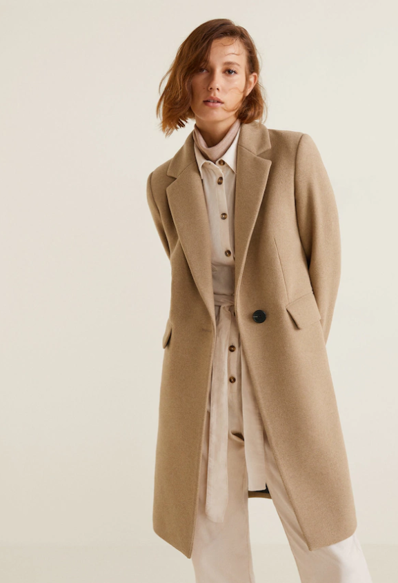 Stay prepared for any professional moment in this  Camel structured coat -staple for a tucked in look