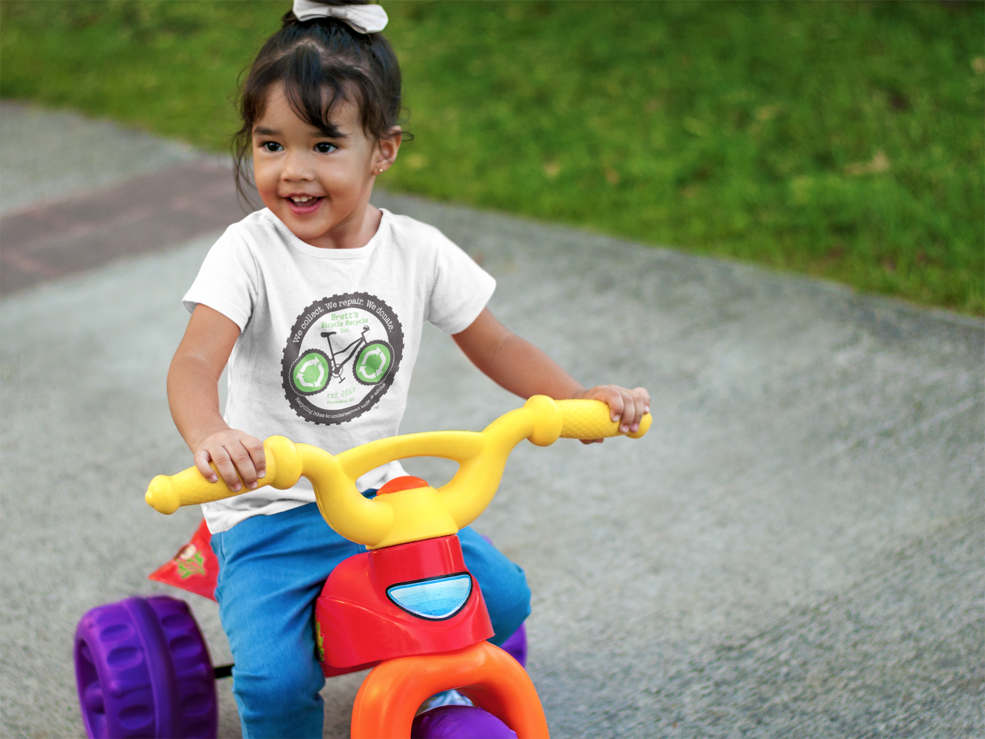 little-girl-riding-a-bicycle-t-shirt-mockup-a7676.png