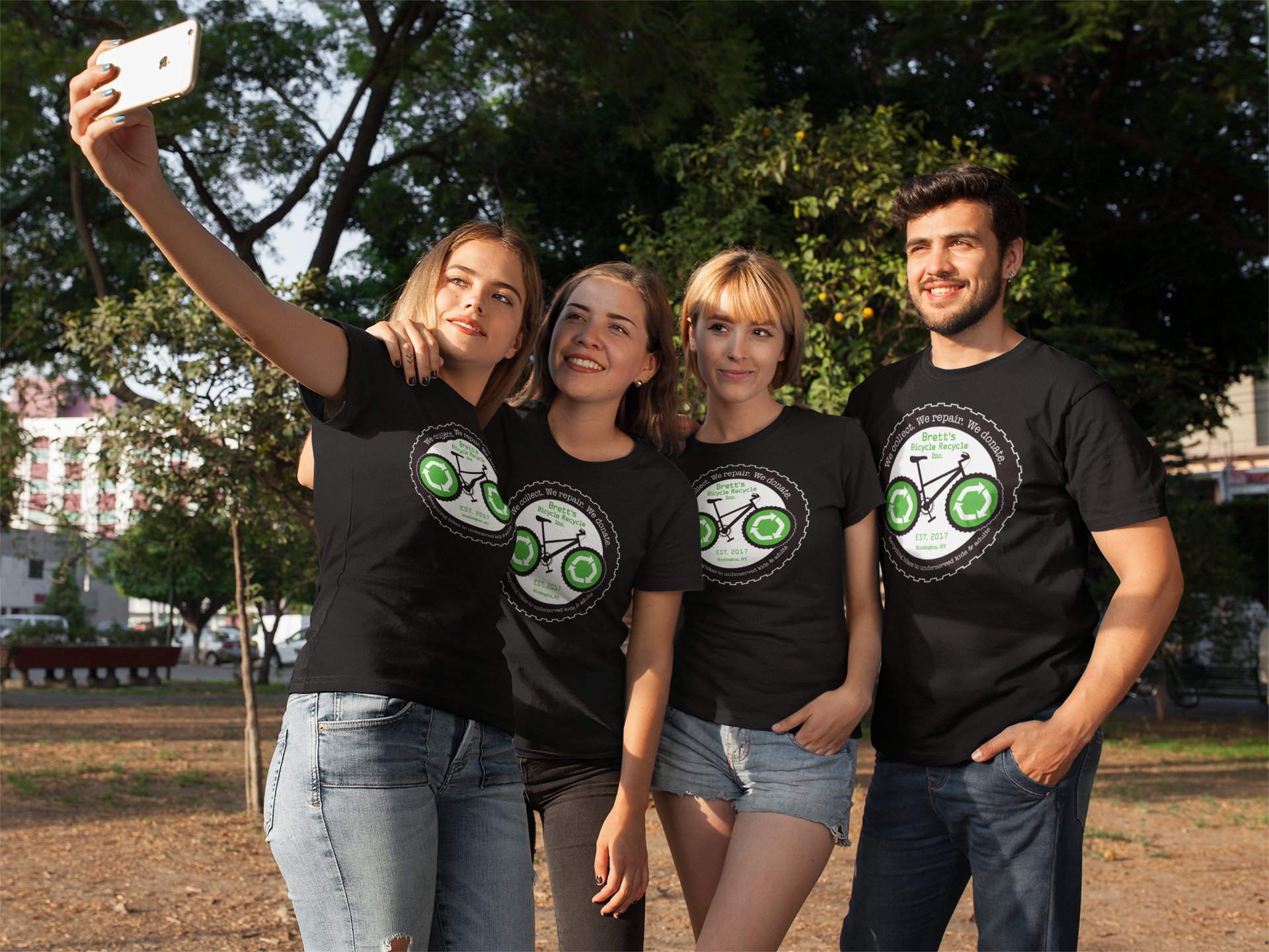 group-of-four-friends-taking-a-selfie-at-the-park-while-wearing-different-round-neck-tees-mockup-a16278.png