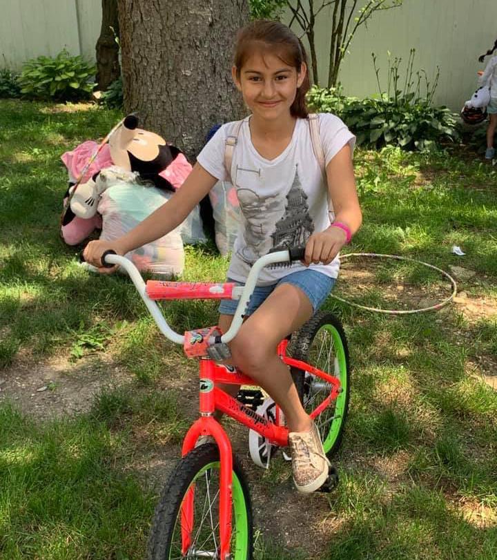 Girl on colorful bike.jpg
