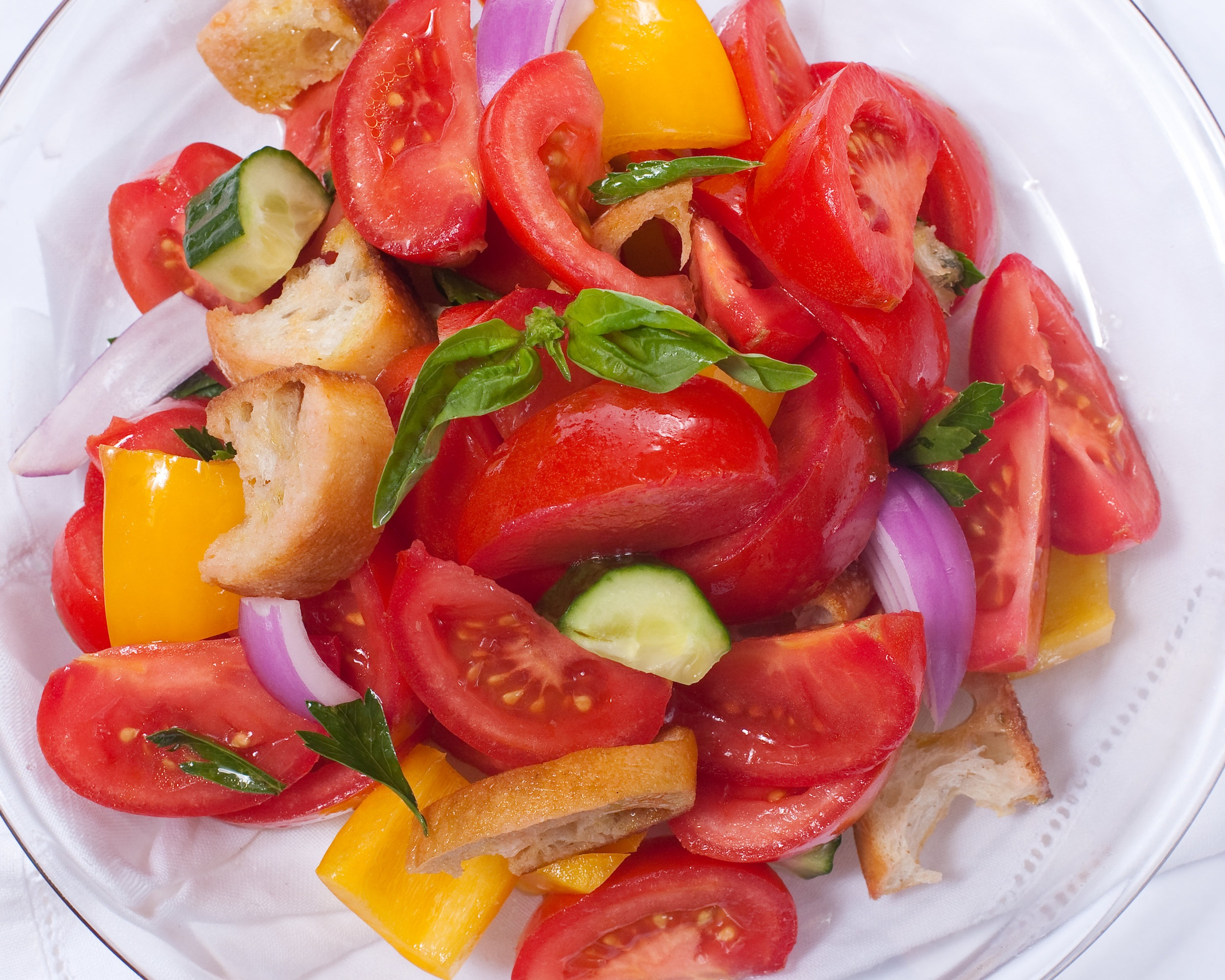 Bread salad with Roma tomatoes, yellow peppers and red onions.jpg
