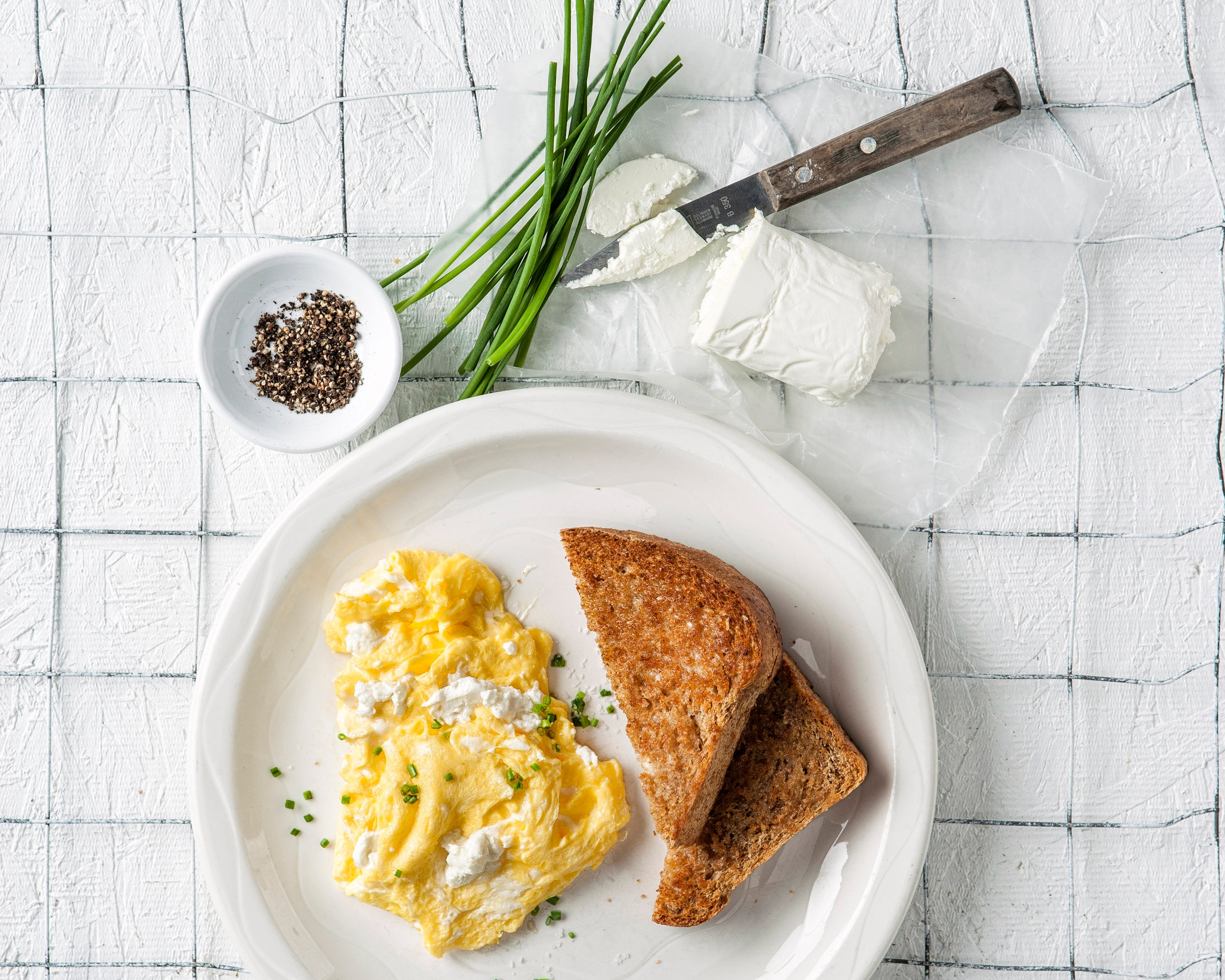 Scrambled eggs with goat cheese and chives.jpg