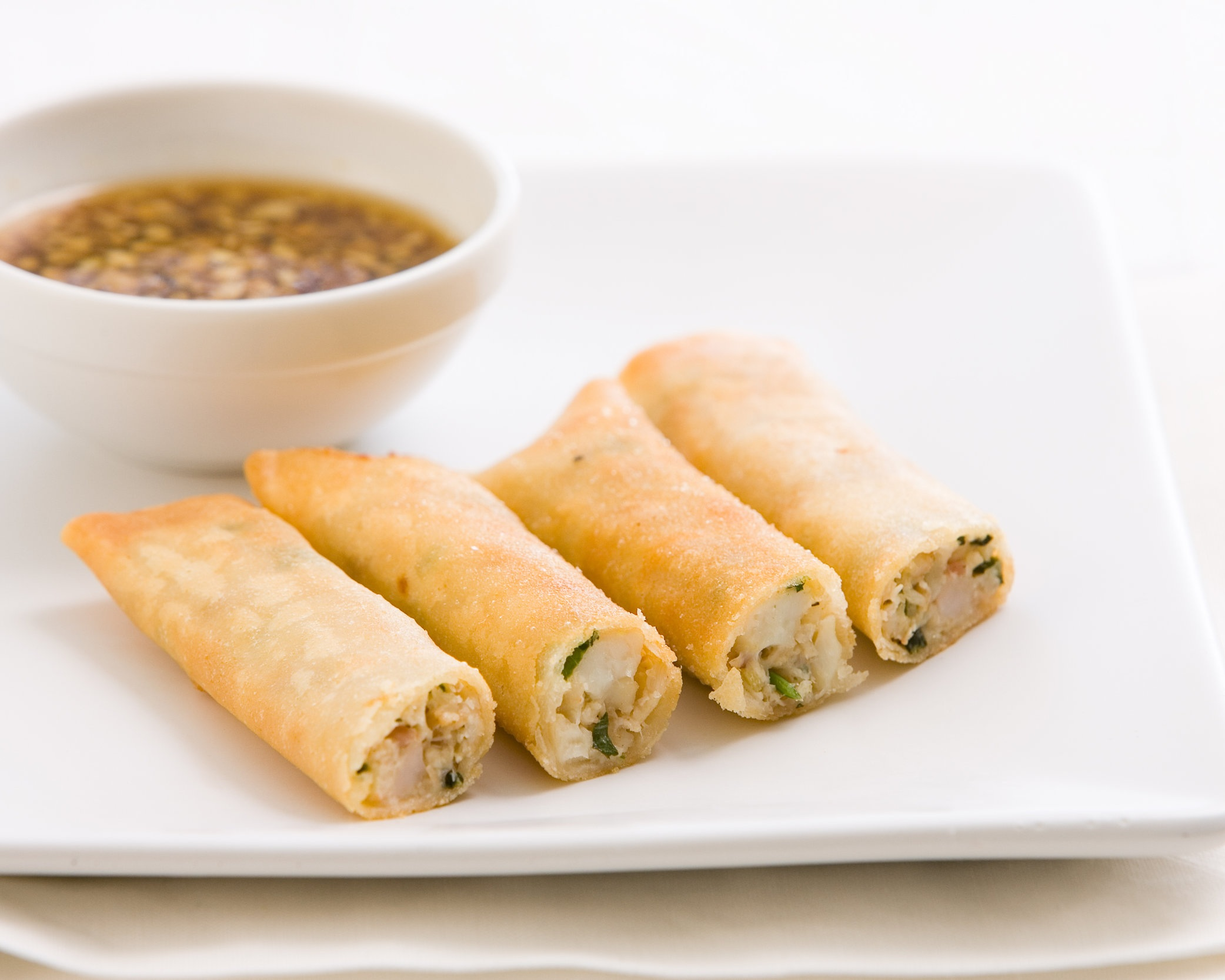 Spring rolls stuffed with fresh crabmeat, halibut, and shrimp.jpg