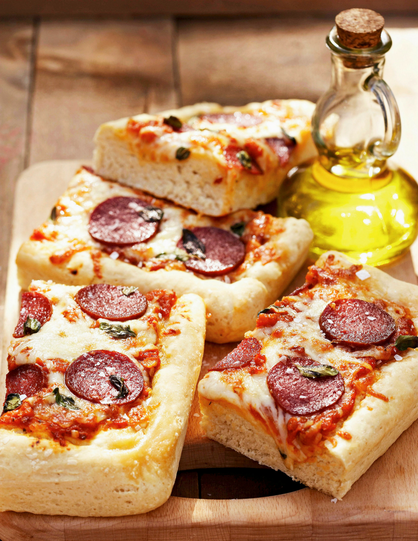 Deepdish pizza with salami and oregano.png