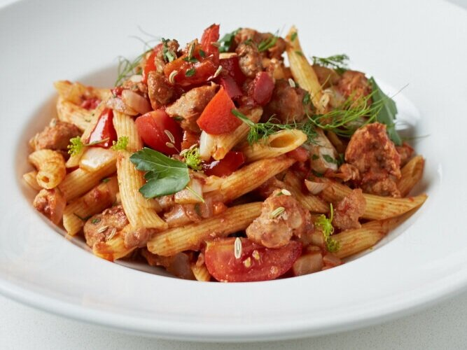 Penne with spicy Italian sausage, tomato, fennel and red peppers.jpg