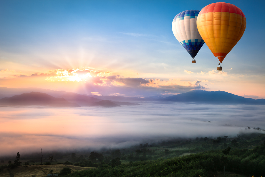 bigstock-Hot-Air-Balloon-Over-Sea-Of-Mi-78959110.jpg