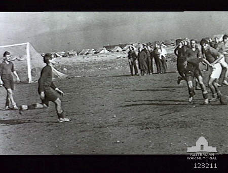 LIBYA. 1943. RAF MEMBERS OF NO. 454 SQUADRON, RAAF PLAYING SOCCER IN THE WESTERN DESERT. -