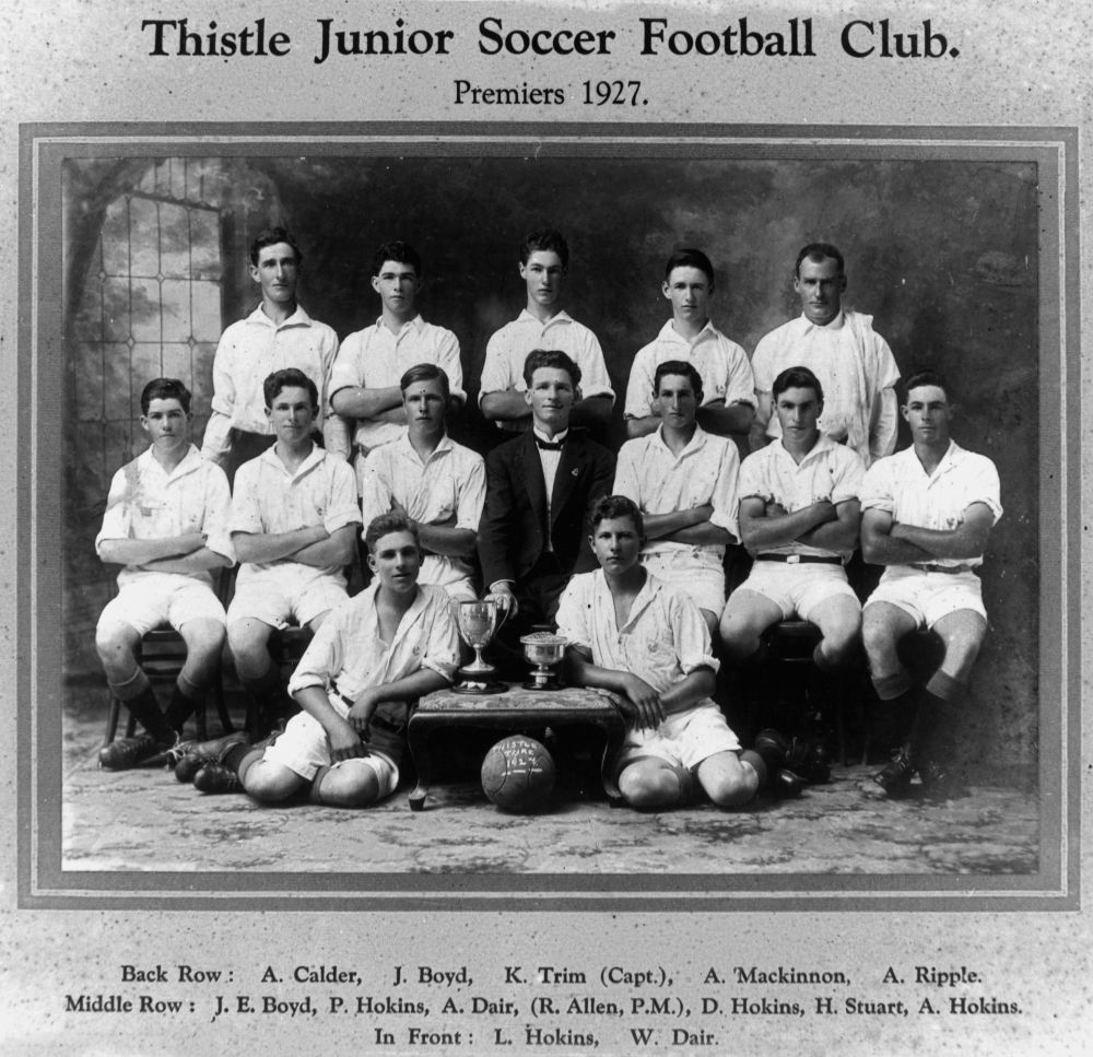 Thistle Junior Soccer Football Club, Premiers 1927 - Back row - A. Calder, J. Boyd, K. Trim (Captain), A. Mackinnon, A. Ripple. Middle row - J. E. Boyd, P. Hokins, A. Dair, (R. Allen, P. M.), D. Hokins, H. Stuart, A. Hokins. In front - L. Hokins, W. Dair. (Description supplied with photograph.)(StateLibQld)