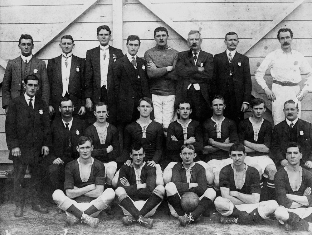 Ipswich and West Moreton British Football Association executive and team that defeated NSW by 4 goals to 1, 1914 - Back row - L. Lonie, A. Shearer, V. Finnimore, J. Sharp, T. Weller, T. Sharp (Chairman), J. Potts, R. Kemp (Referee). Middle row - W. Scott, W. Kerr (Treasurer), A. Gibb, W. Paterson, G. Simpson (Captain), G. Burns, D. Potts, T. W. Crane (Hon. Secretary). Front row - A. Heaton, R. Scholes, T. Wade, J. Breslin, C. H. Pearce.(TROVE)