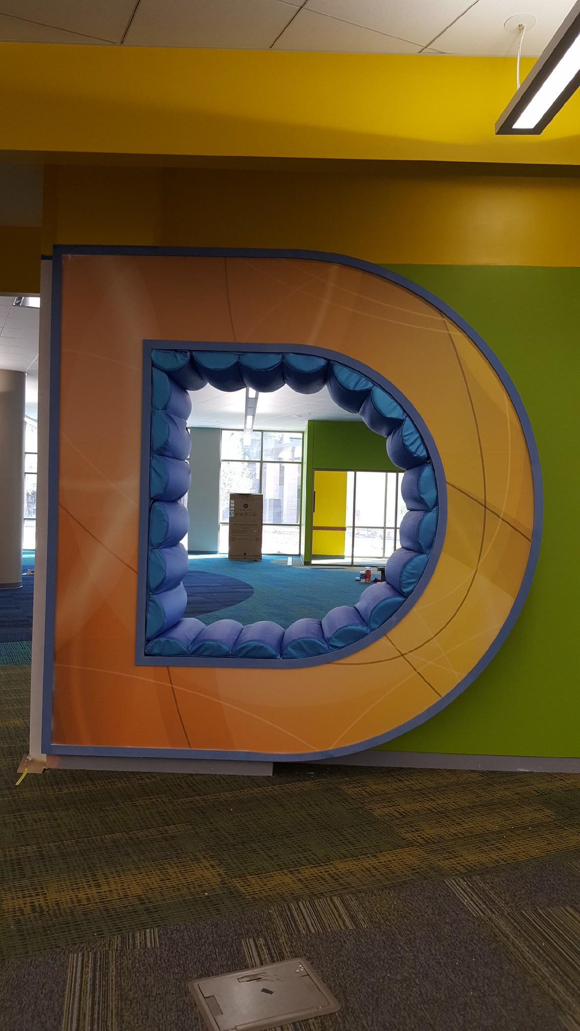 Interior seats for D and O – a local library installed a wall that was made of letters that spelled DISCOVER.