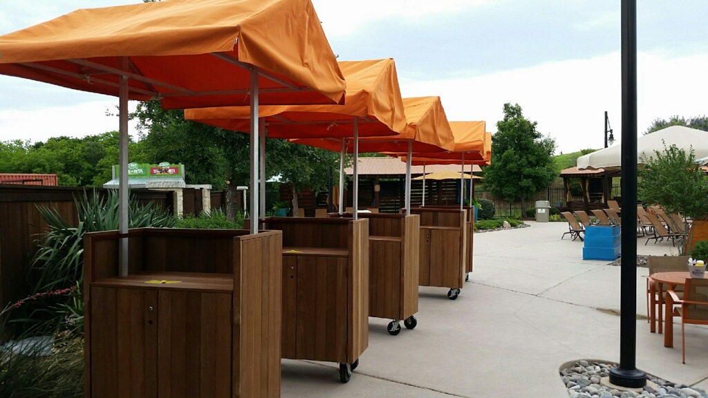 Orange canopies – a local swim club needed canopies for monitor kiosks. They were made with sunbrella fabric. I had to engineer, create a pattern and construct.