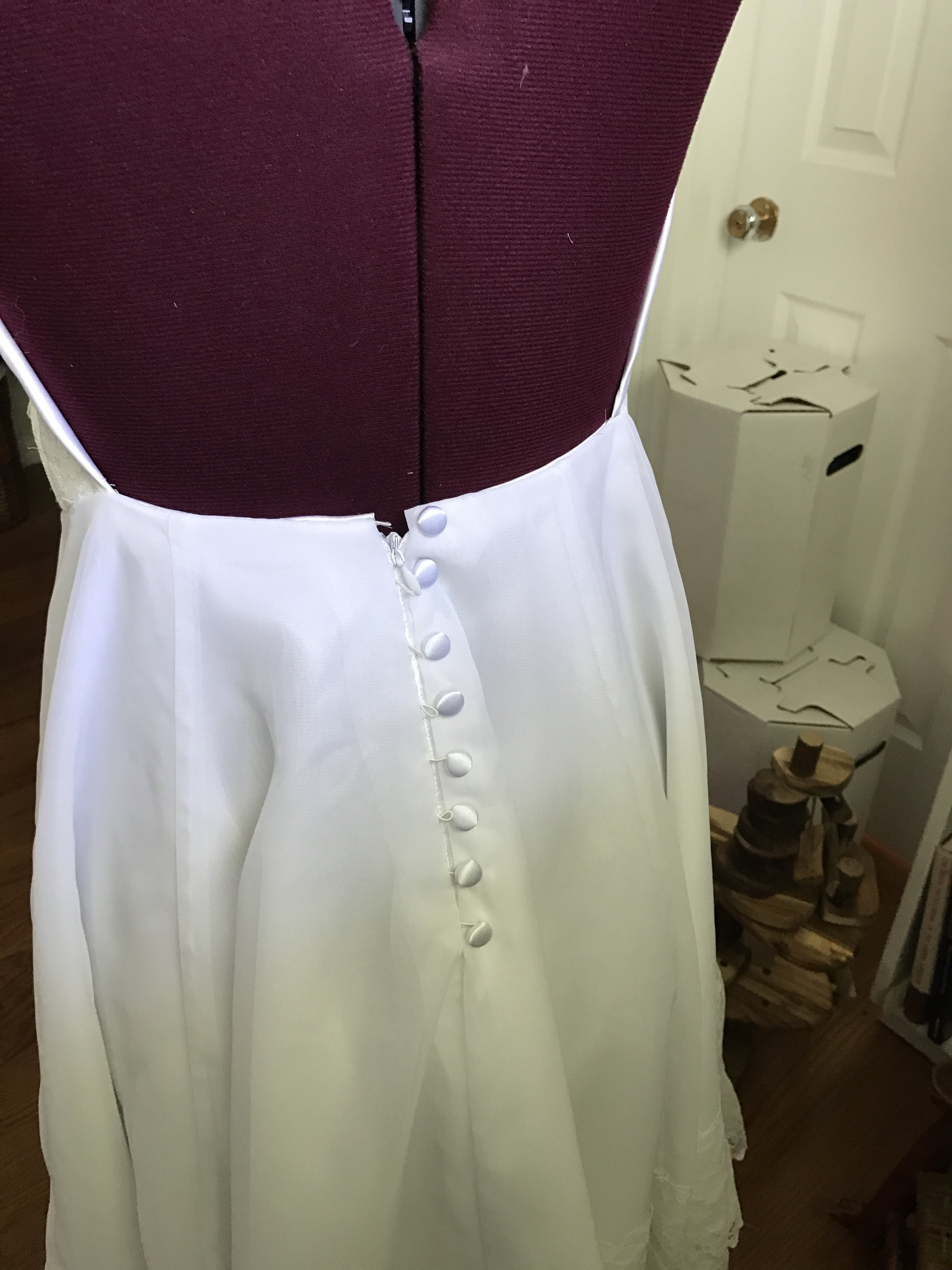This one started as a long sleeve wedding dress from the 80s. I made it modern and fitted it to her daughter.