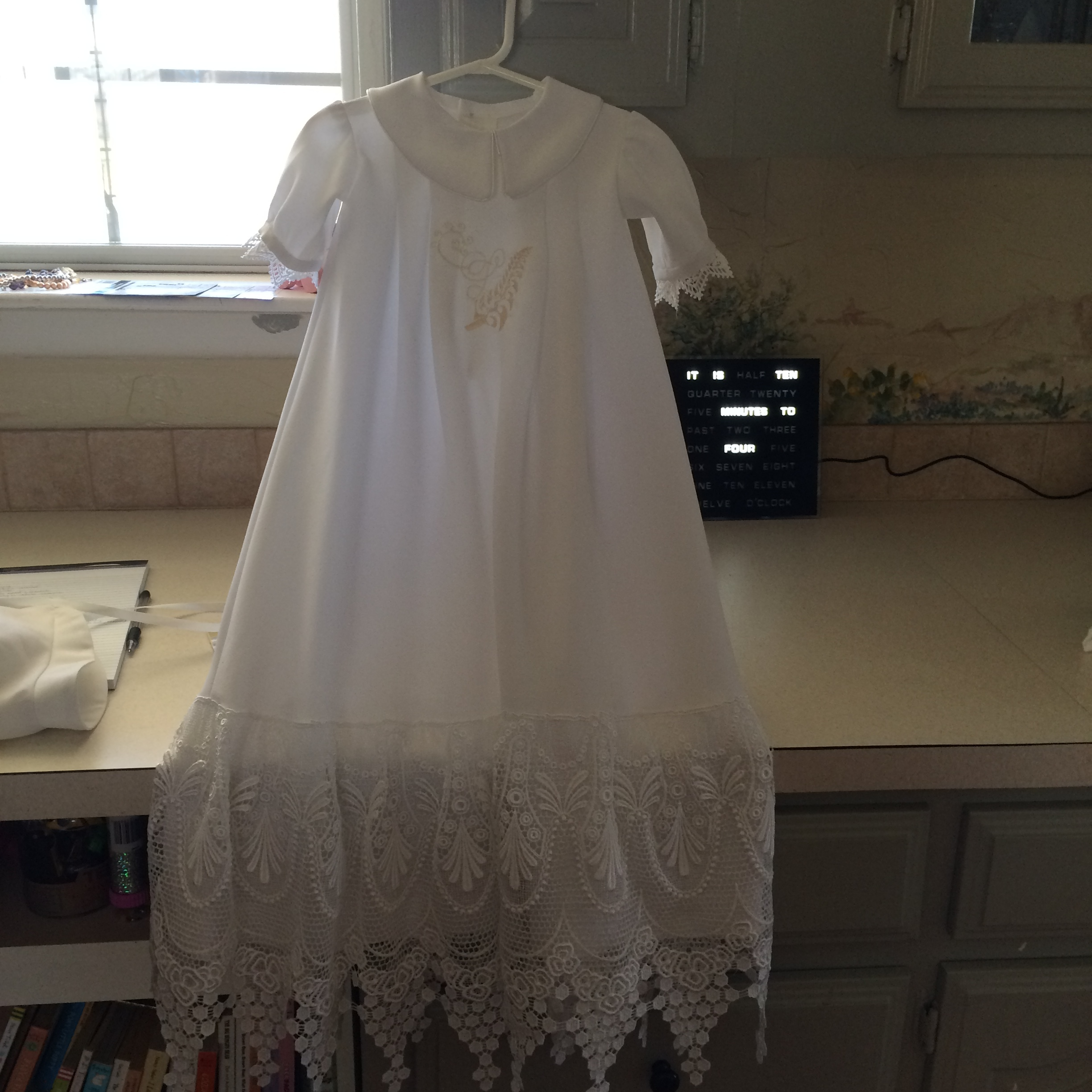 Christening gowns, made out of a grandmother's wedding dress with custom embroidery, she told me what she wanted and I drew the embroidery.
