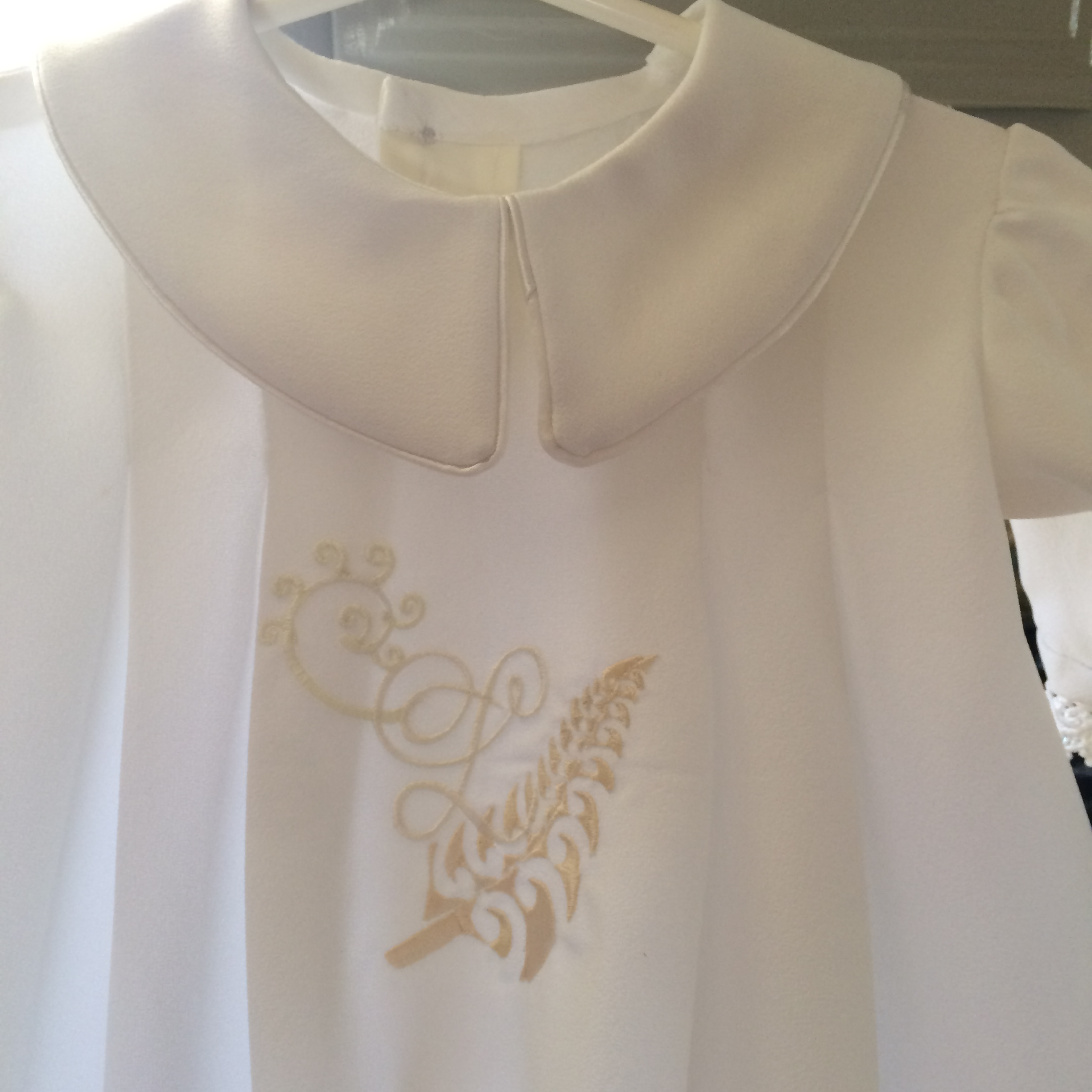 Custom hand drawn embroidery on Christening gown.