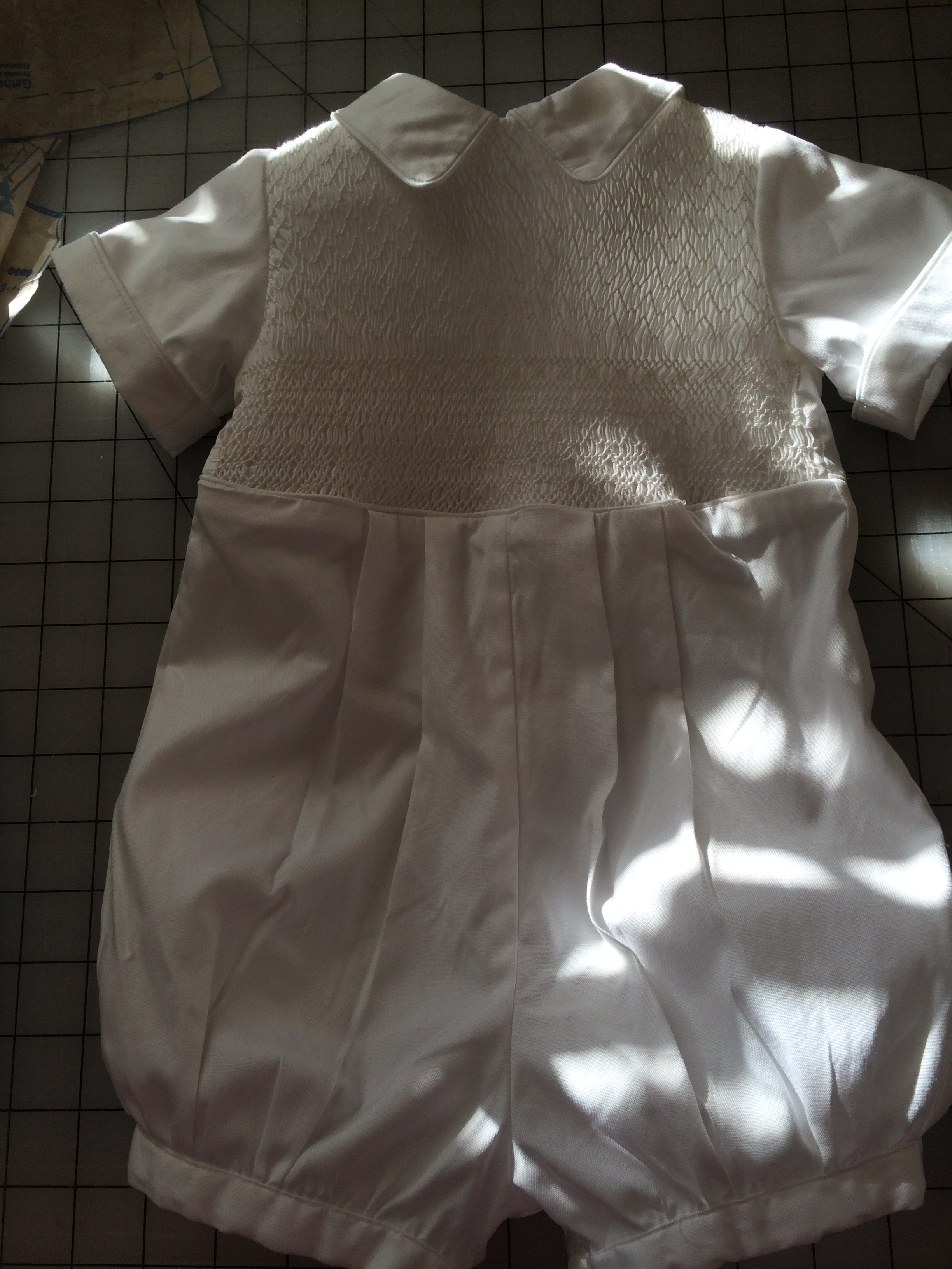 Smocked white baby outfit.