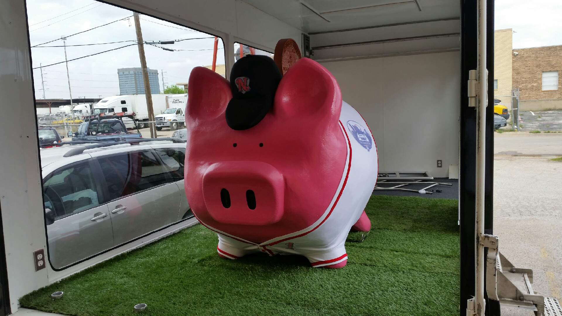 Huge pink pig – the pig was a mascot for a bank. His name was Hamilton and the bank wanted him to be dressed in the baseball uniform of the local triple A team.