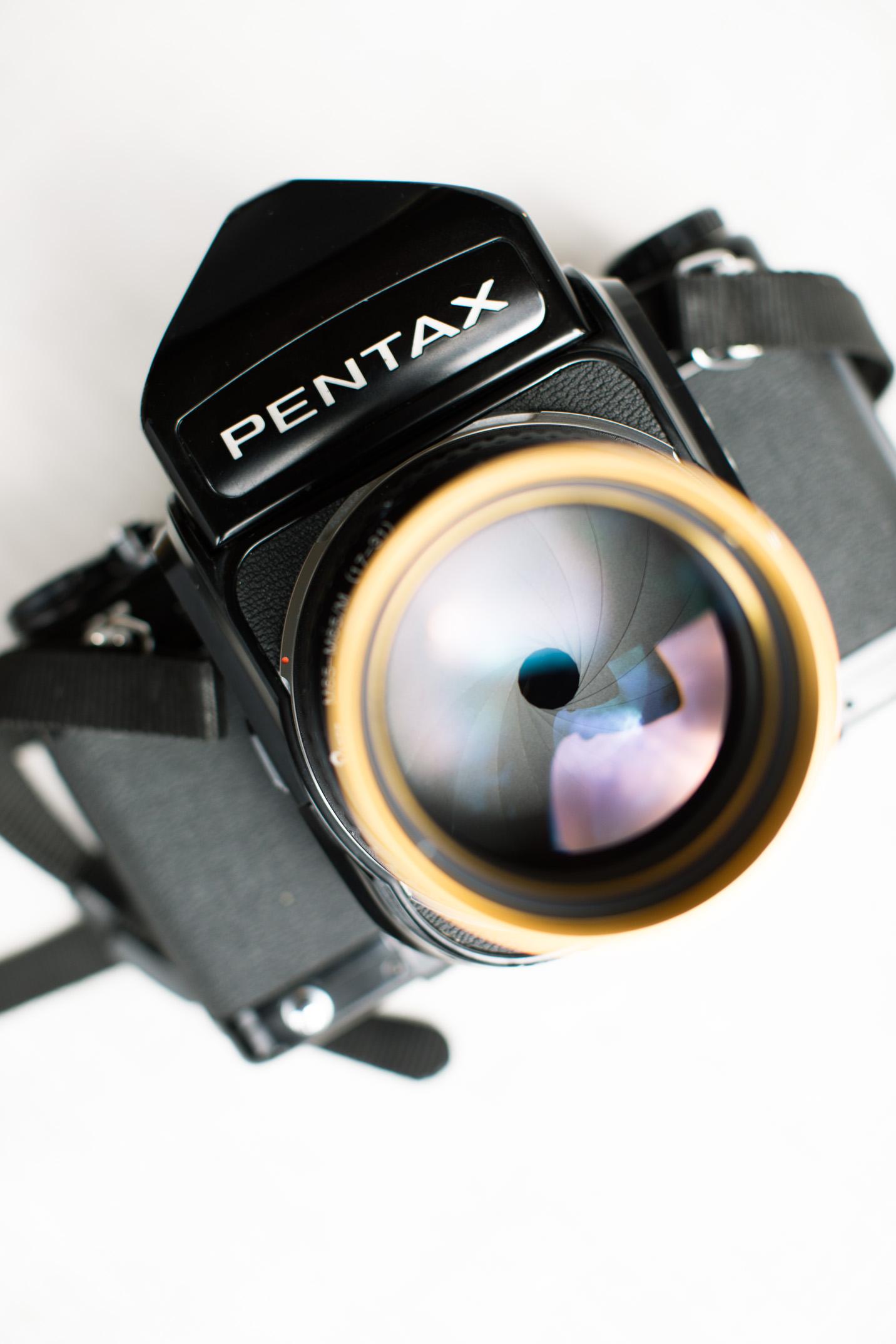 Photo of Schneider Cine-Xenon 115mm f/2 mounted on a Pentax 67 film camera