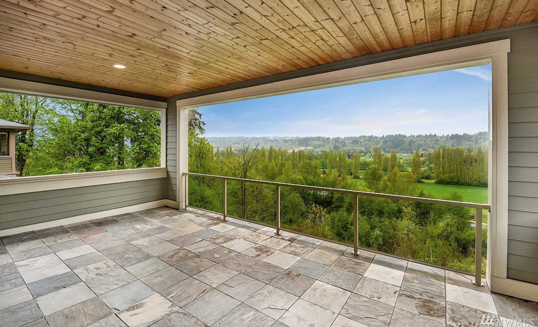 One of three private terraces, all adorned with warm-woodsy modern PNW  design and outdoor lighting!