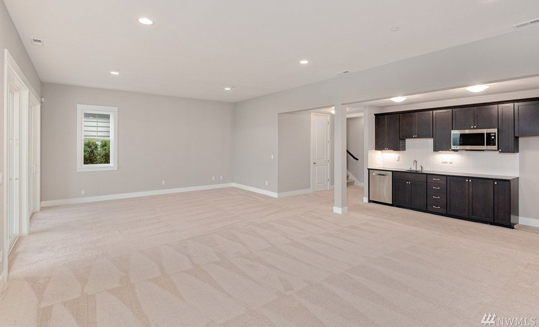 Huge finished 12' ceiling lower level with 2nd kitchen, 2nd formal master and beautiful play space, theater room or View master retreat, with private terrace!
