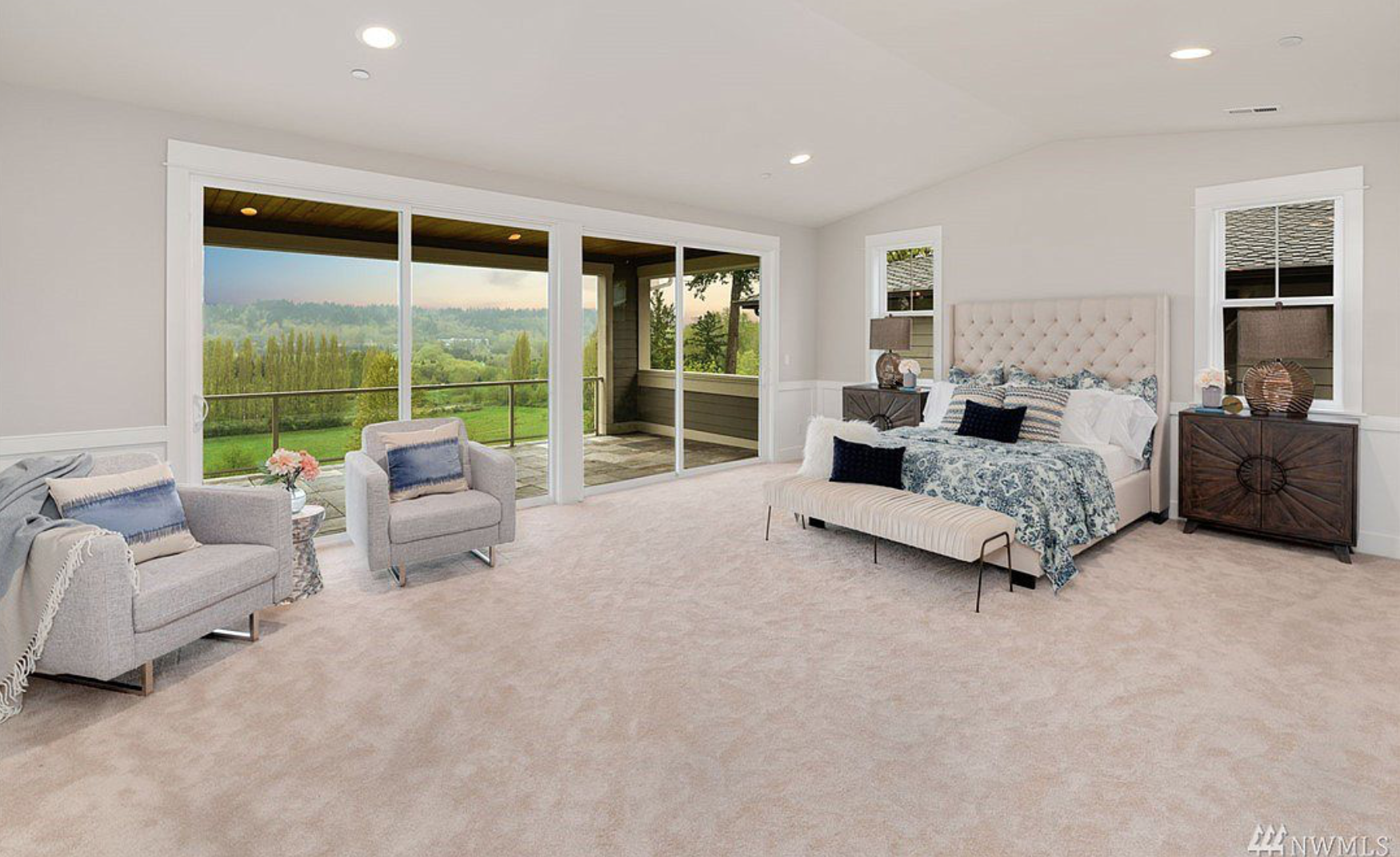The massive master bedroom features a private west facing terrace, his and hers closets with a washer & dryer hook up!