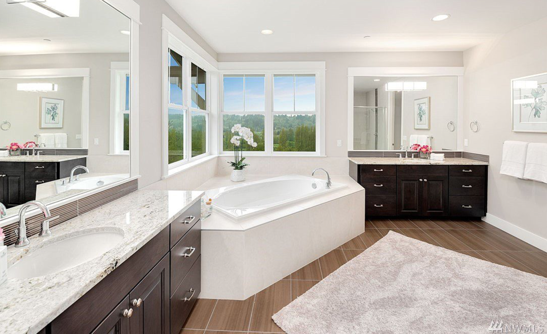 The master bath is complete with his and her's vanities as well as a soaking tub looking out onto the protected wetlands!