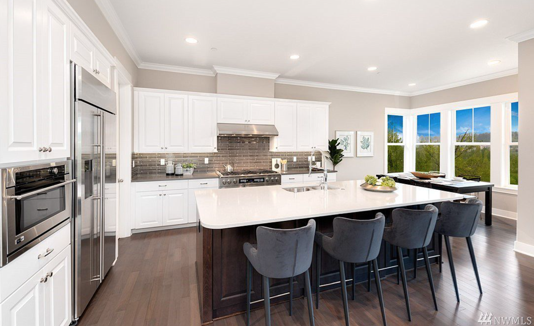 Incredible Chef's kitchen and walk-in pantry complete with a breakfast area and luxe details throughout!