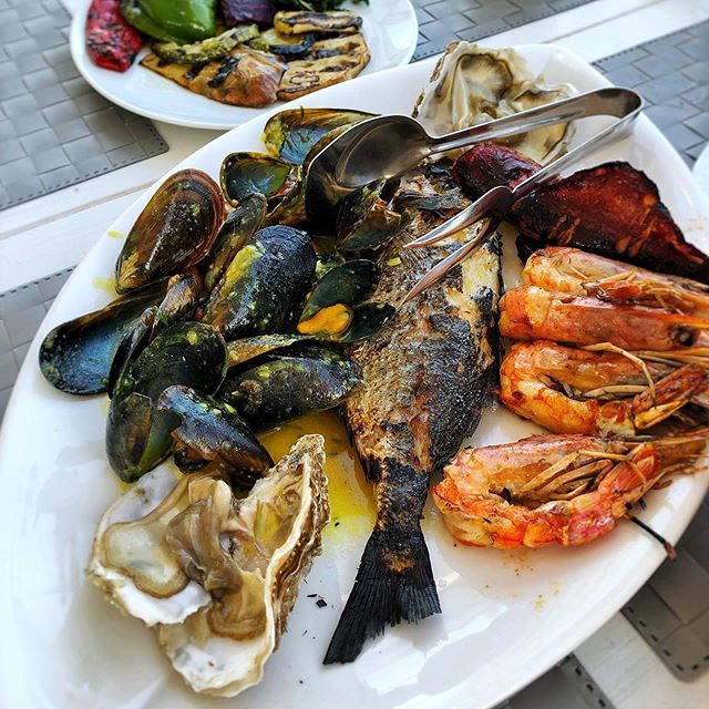 Enjoying a fresh seafood dinner for two after a day of shopping in Oia  #firasantorini #fira #santorini #greece #seafood #freshseafood #santorinigreece🇬🇷 #santorinifood #santorinirestaurant #dinnerinfira #travel #thira # greekislands #vacation #instagood #instatravel #travelgram #wanderlust #greekislands