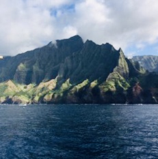 NaPali - Later that week, we took a boat up to NaPali, the northern coast of Kauai. No roads up there. It was spectacular that day. No waves, just beautiful ocean and the occasional whale and dolphin. Here are some pics I took of that outing. I've been up there a dozen times and never get tired of the scenery. It's the most photographed place on Hawaii. Sunset was behind some clouds but still gorgeous!We were lucky to have made the trip when we did, as the very next day a twenty foot swell arrived from the north bringing thirty to forty foot waves. Even the Jaws surf contest in Maui had to be cancelled because of the size of those monsters.