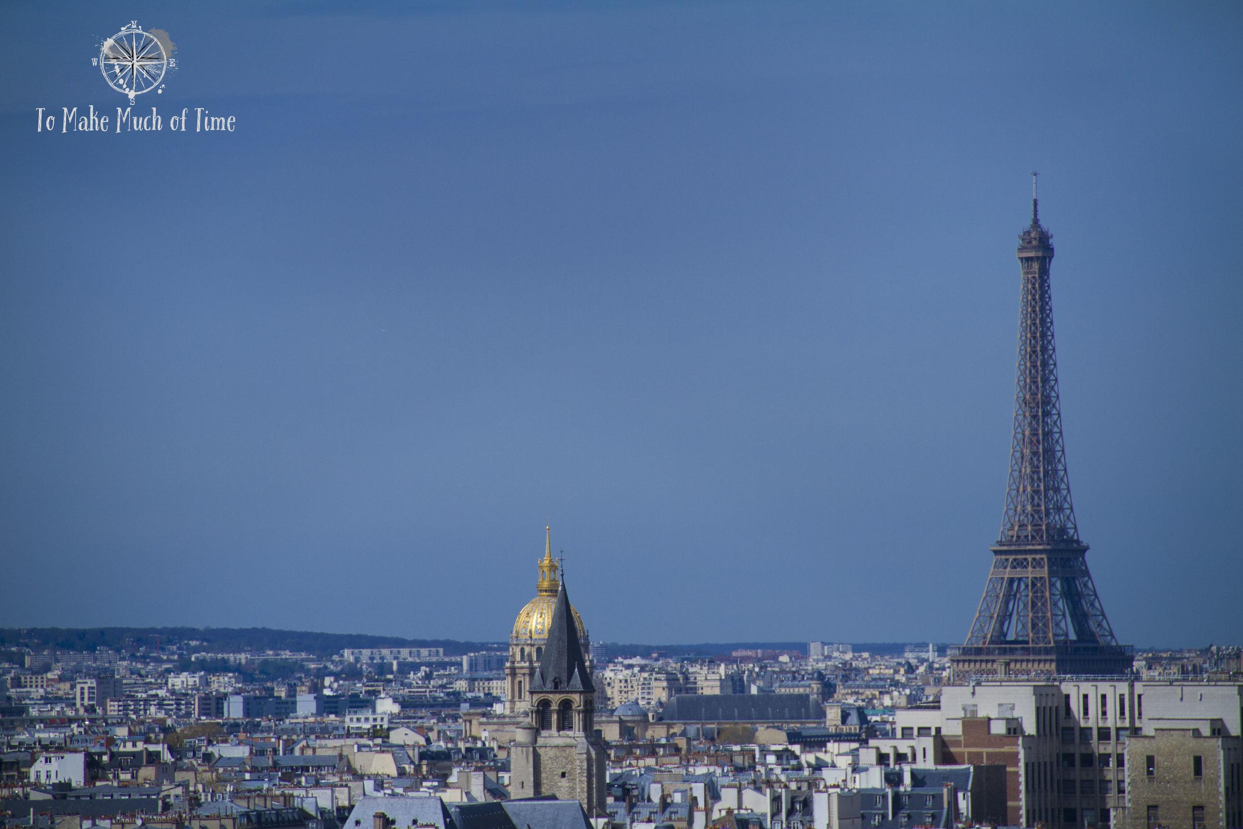 The Eiffel Tower is far away but seems closer through the zoom lens.