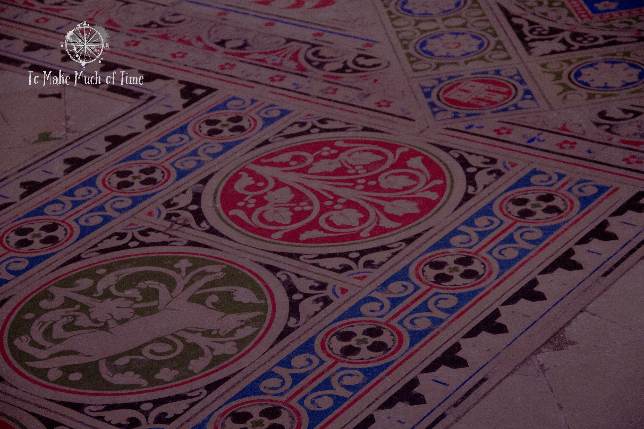Even the floors of Saint-Chapelle are decorated. You'll notice the pinkish hue from the blue light streaming through the windows.