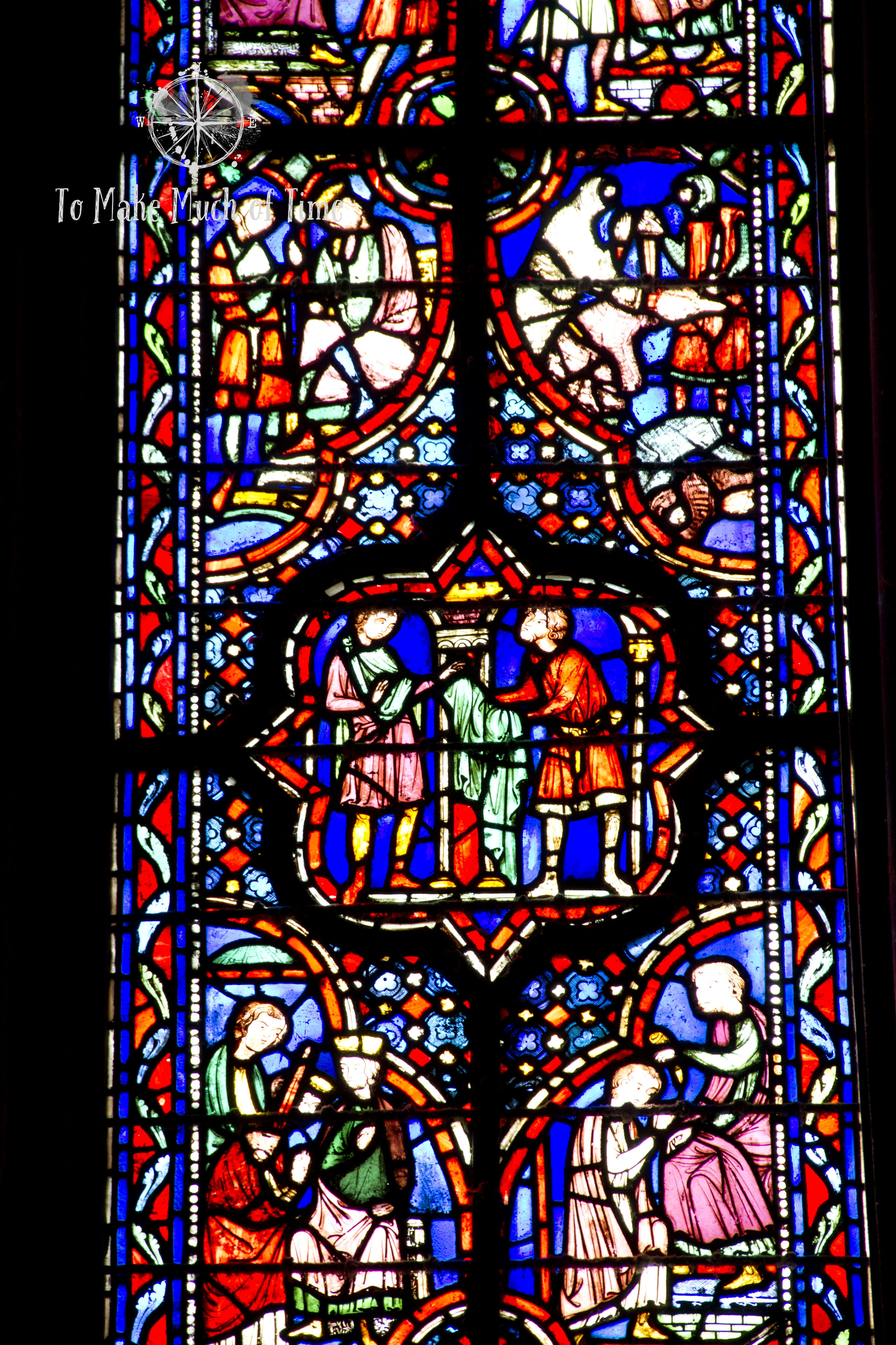Zoomed in photo of a segment of the stained glass panels seen in the next image.