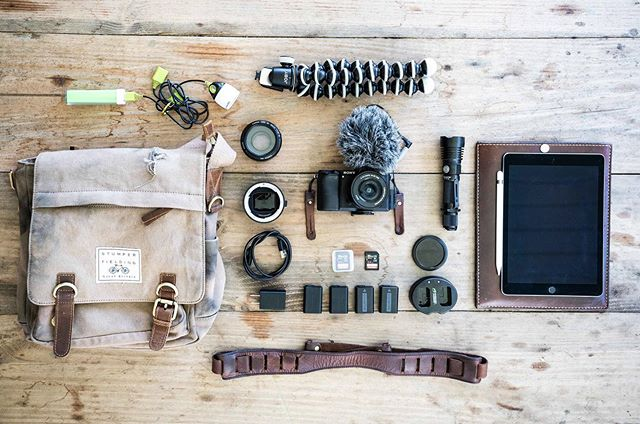 What's in your travel bag? Here's a quick shot of some of our favorites for traveling light ✌🏼 . . . @tylerfedwards #cameragear #gearshot #videogear #travelessentials #packinglight #camerabag #weekendbag #videographygear #videographer #charlestonvideographer #readytoroll #traveltoexplore #stumperandfielding #tannergoods #jobyinc #flatlay