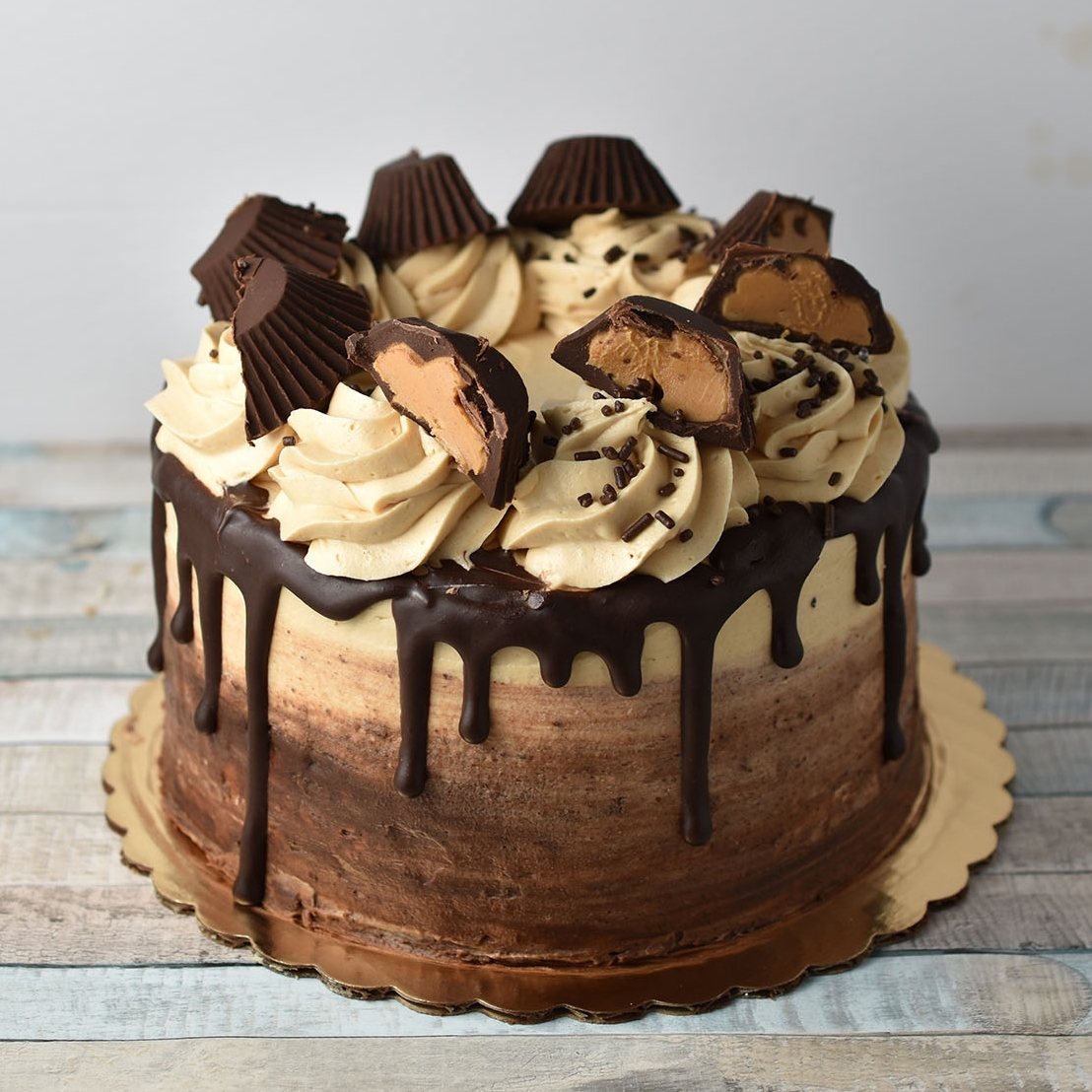 Peanut Butter cuP - The marriage of the two best flavors known to man. Chocolate and peanut butter bring joy to our tastebuds. Chocolate cake, fluffy peanut butter frosting, and ganache.Gluten Free option available