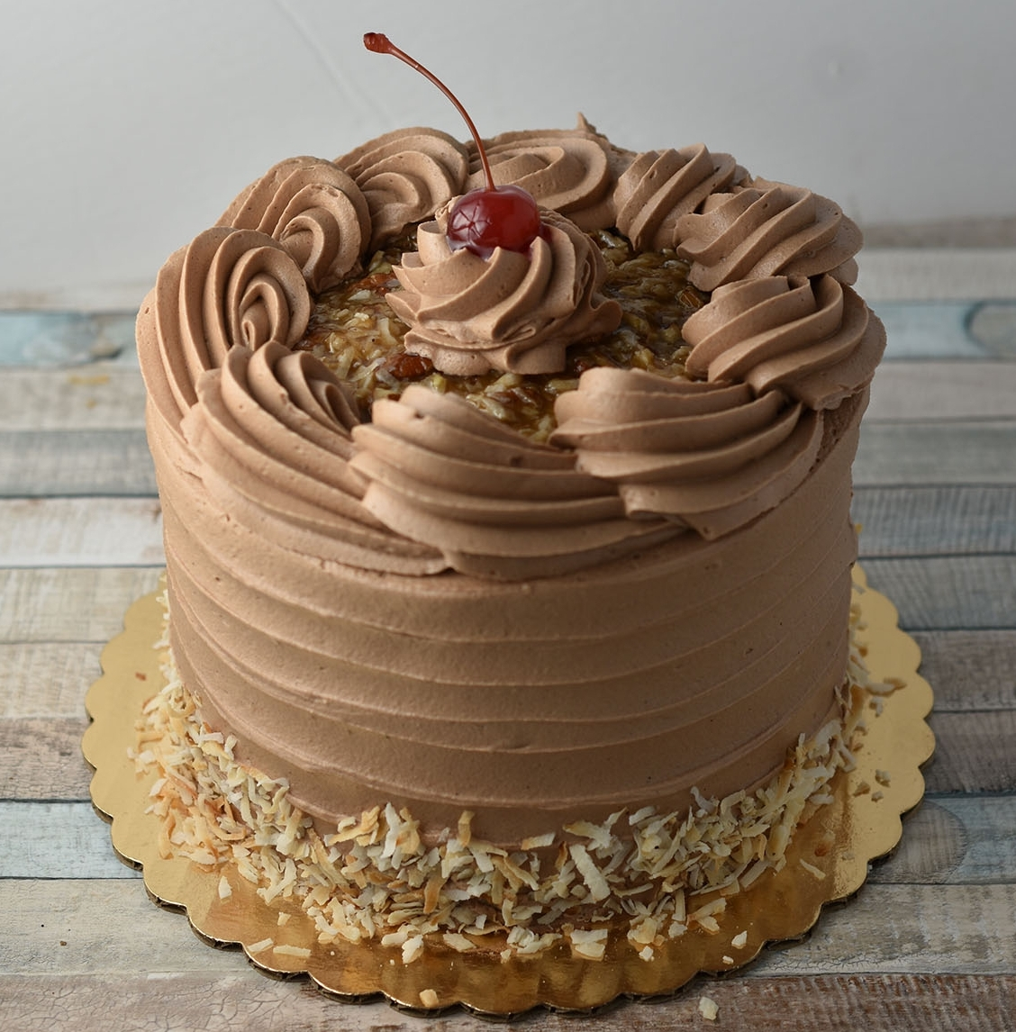 German Chocolate - Just like you remembered it! A creamy mixture of homemade caramel, pecans, and coconut between layers of moist chocolate cake and creamy chocolate frosting.Gluten Free option available.