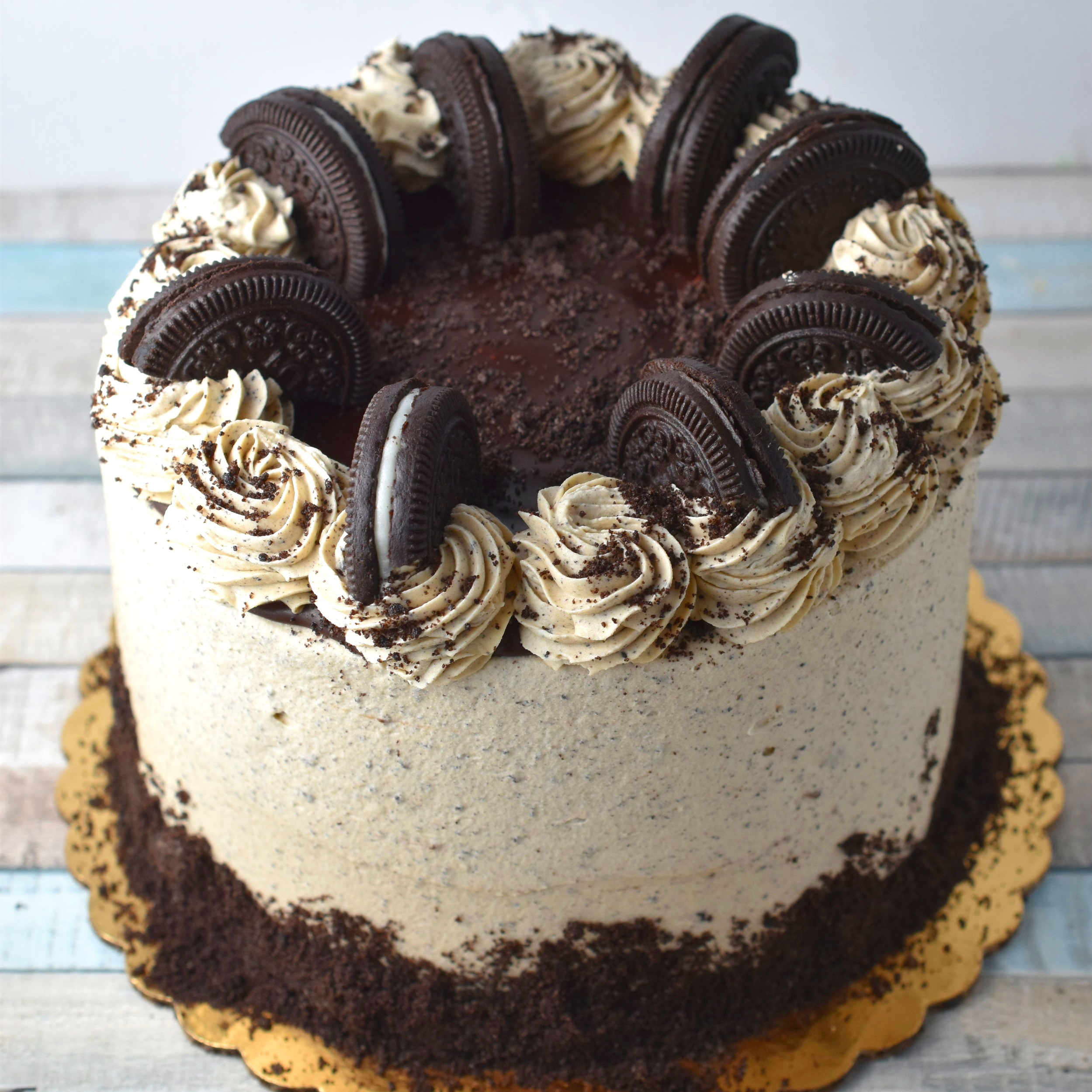 Espresso Cookie - Time for a coffee break! Give yourself a little extra get up and go with our espresso infused cake. The espresso frosting is filled with a crushed all natural version of an oreo and covers our popular chocolate cake . Sandwiched between the layers is our rich chocolate ganache.