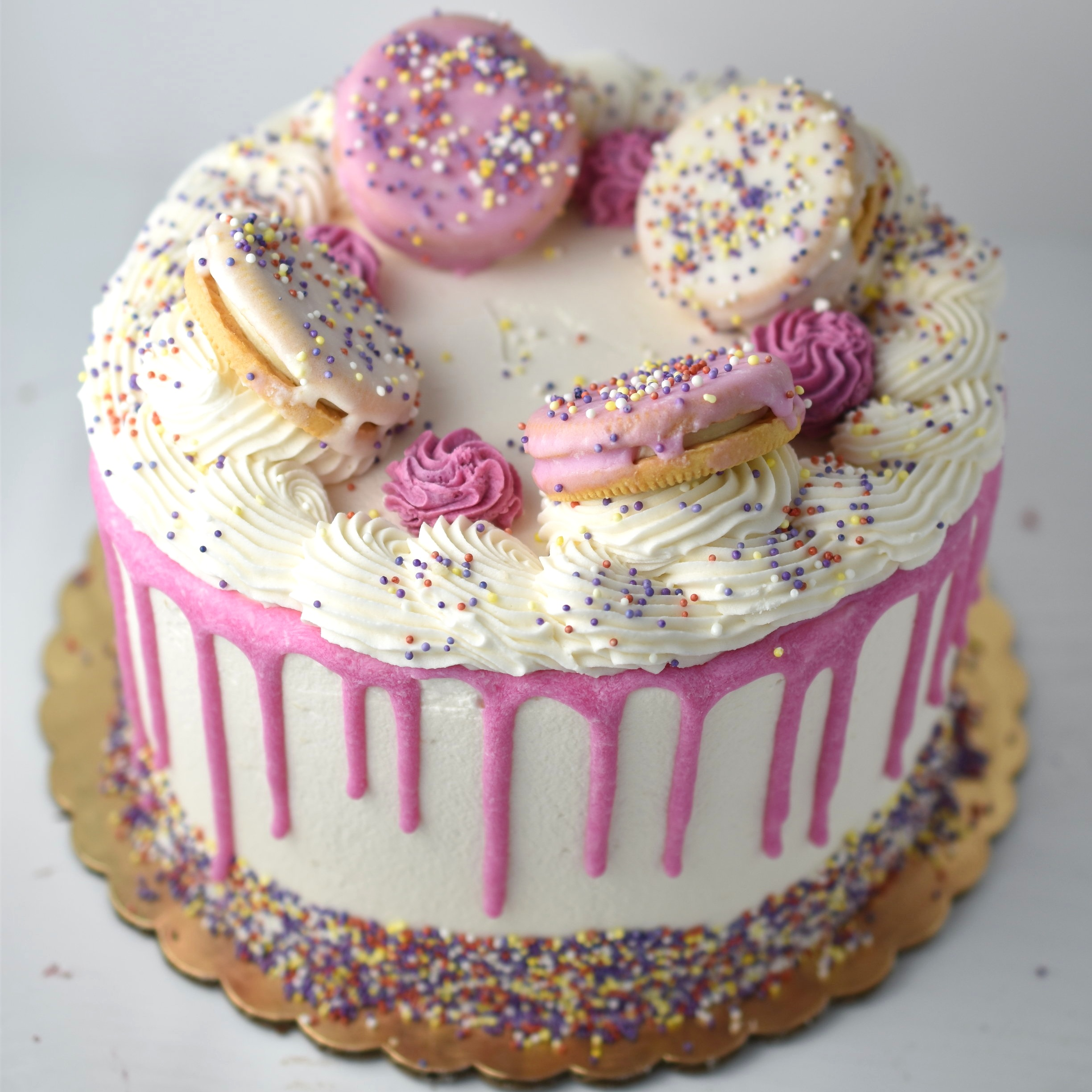 Animal cracker - Do you remember those adorable pink frosted animal crackers we loved as child? Now you can have it in cake form! Vanilla cake filled white chocolate ganache and crushed cookies. Top it off with some fluffy vanilla frosting and you've found heaven
