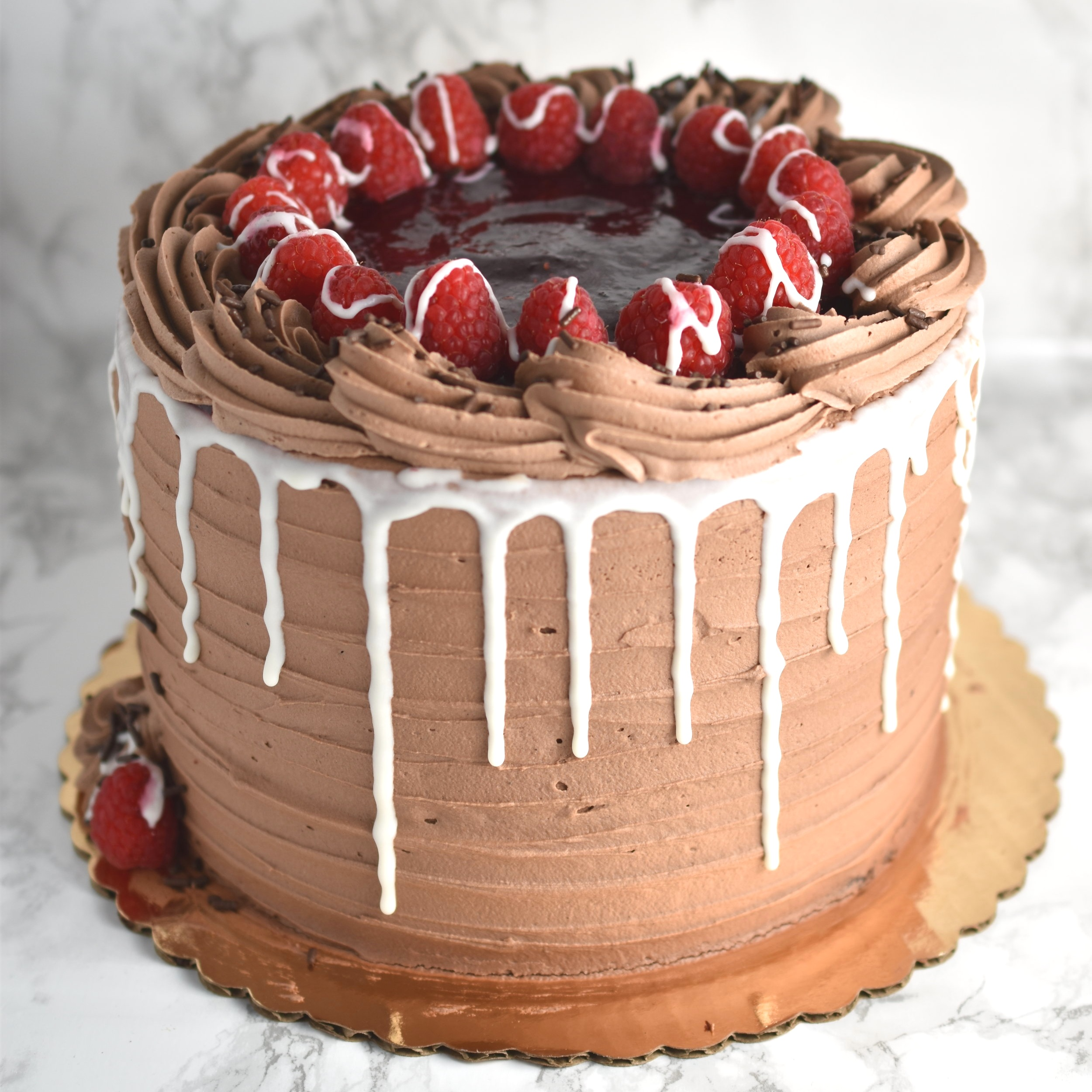 Chocolate Raspberry  - Chocolate cake, Raspberry filling, chocolate frosting, and ganache..