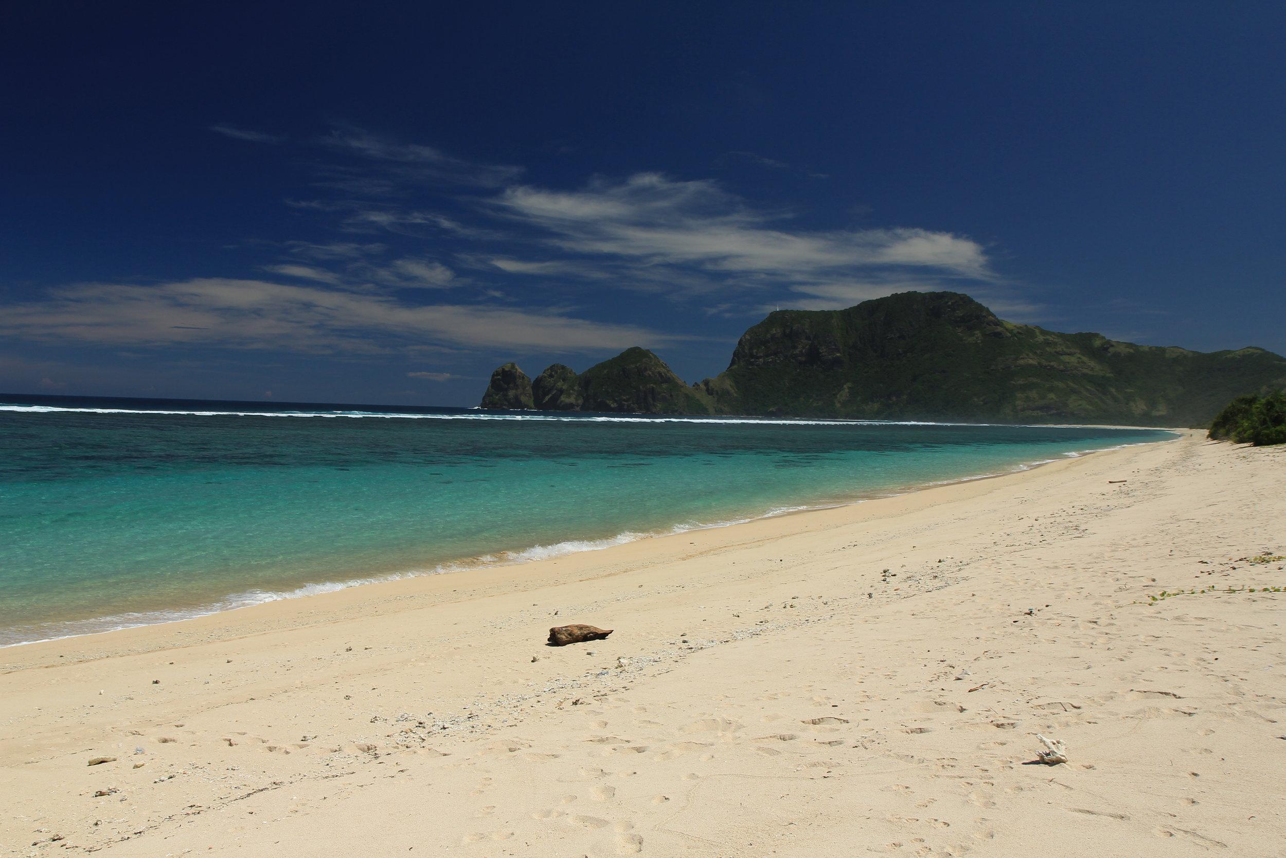 Sandy beach and blue ocean