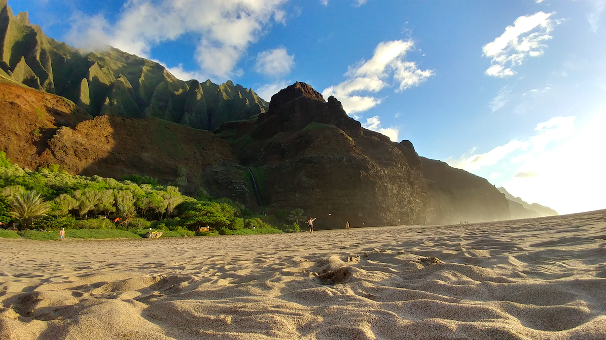 Sandy beach and mountains in Kauai