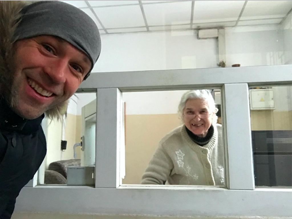 Peter Santenello and old granny in Kyiv, Ukraine