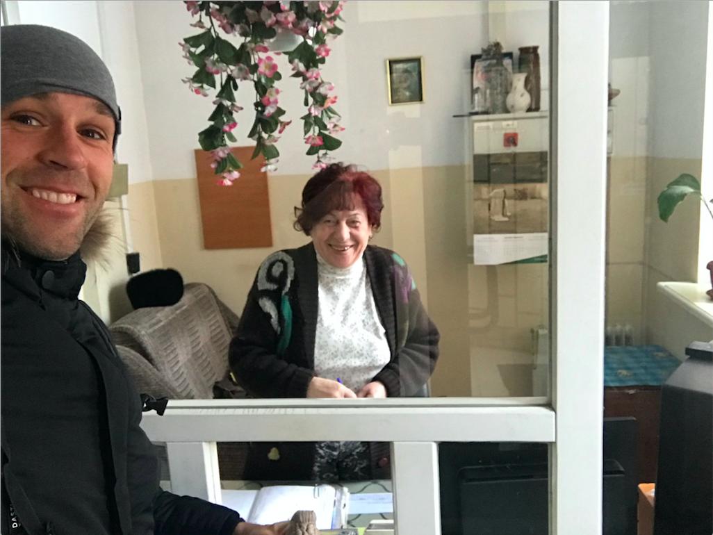 Peter Santenello and old woman in Kyiv, Ukraine
