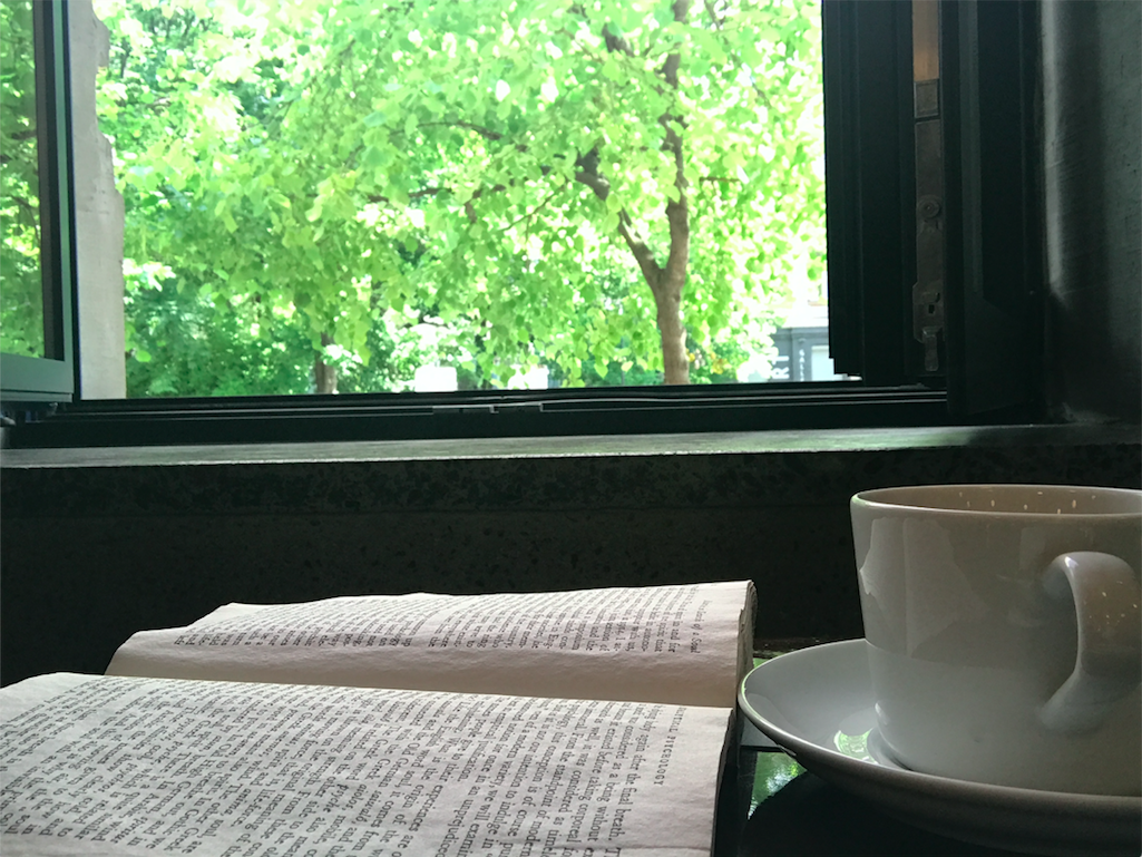 A cup of coffee and a book in Kyiv, Ukraine