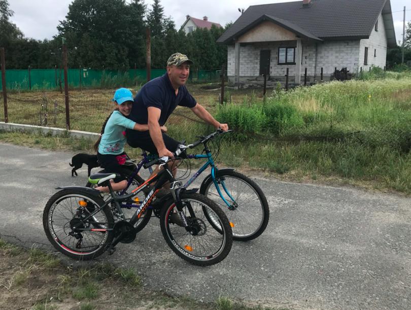 Ukrainian and his daughter riding bikes