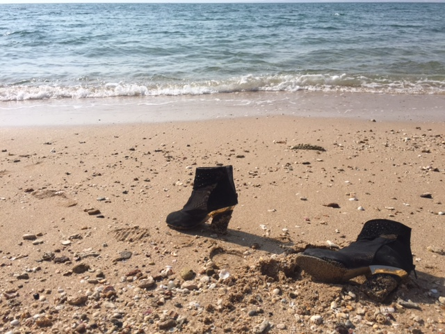 Boots near the water in Iran