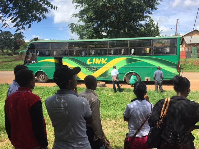 People and bus in Uganda