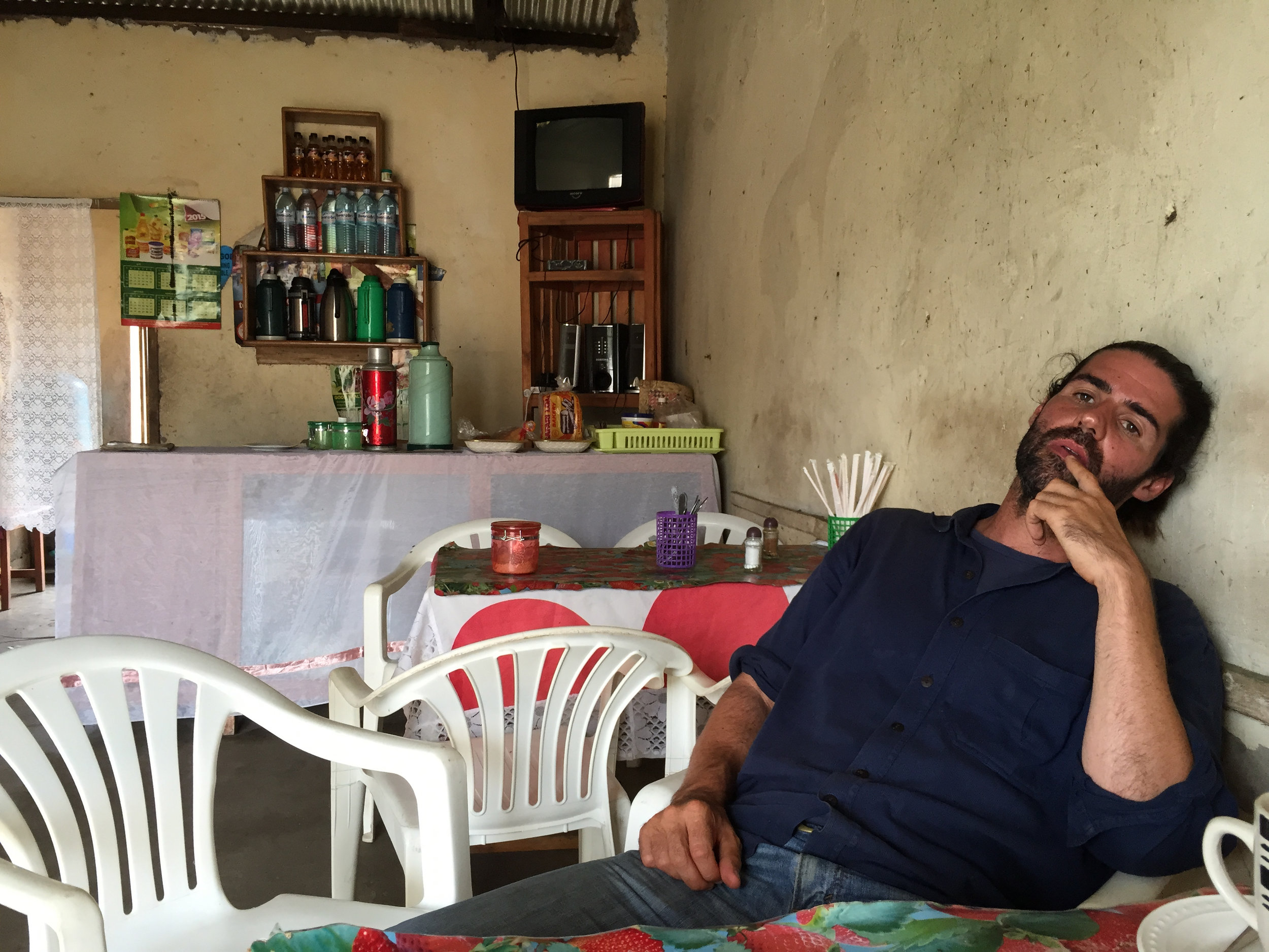 A man is sitting in an Eritrean cafe