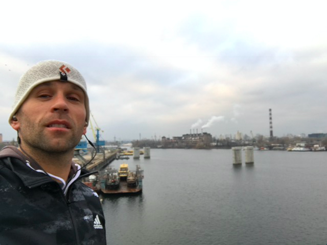 Peter Santenello is running along the Dnipro in Kyiv, Ukraine