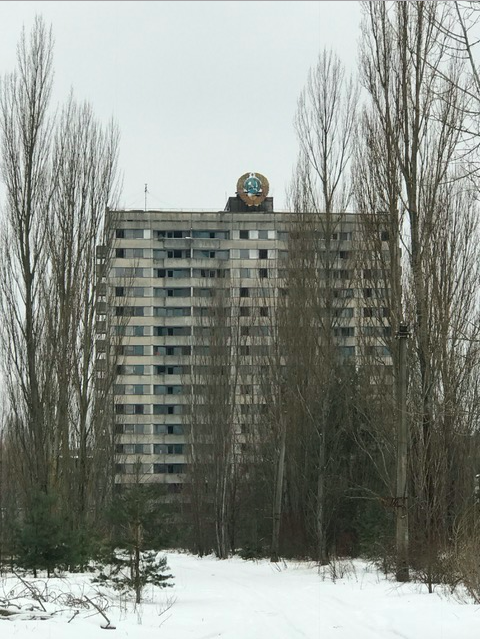 "Ghost city Pripyat. Nature taking over. Hamer and sickle on top of a ""block."""